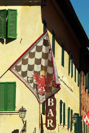 Low Angle View Building Exterior Bar Sign Italy🇮🇹 Flag Patriotism Built Structure Architecture Flag In Wall Flag On Building Week On Eyeem Outdoors Sunshine ☀ Tranquility National Statement Tradition And Culture Toscana Siena