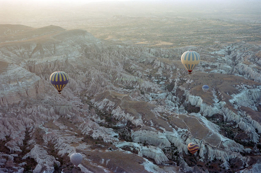 Adventure Air Vehicle Ballooning Festival Beauty In Nature Day Extreme Sports Film Photography Filmisnotdead Flying Fog High Angle View Hot Air Balloon Landscape Mid-air Mountain Nature No People Outdoors Parachute Paragliding Rock Formation Rock Hoodoo Scenics Sky Transportation