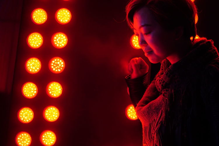 Lights One Person Illuminated Adult Young Adult Indoors  Dark Glowing Light - Natural Phenomenon Night Side View Nightlife Not Looking At The Camera Asian Girl Asian  Hong Kong Neon Neon Lights Neon Colored International Women's Day 2019 The Portraitist - 2019 EyeEm Awards The Street Photographer - 2019 EyeEm Awards