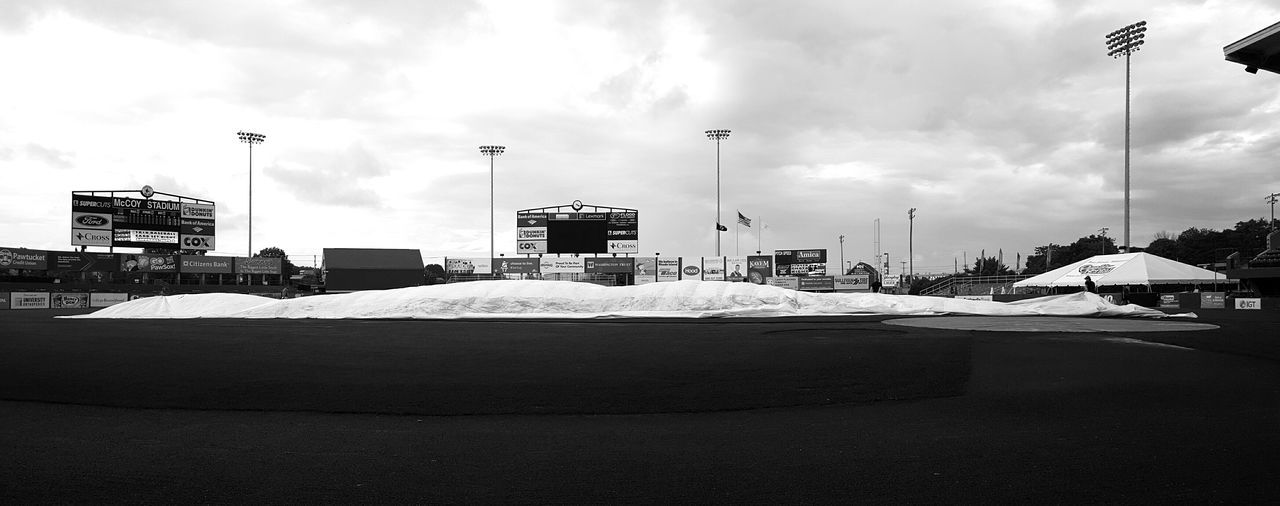 Game on. Ground's Crew Pulling Tarp Off Field Playing Field Built Structure Baseball Park Park - Man Made Space Footpath Cloud - Sky Sky Best Seat In The House View From Dugout Minor League Baseball  Field Paw Sox Game Red Sox Nation Rhode Island Photography⚓ EyeEm Panoramic View Outdoors Tall - High EyeEm Best Shots - Black + White Cloud Day B&w Edit S6