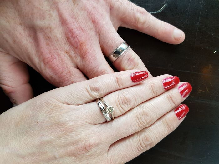 Cropped image of married couple with wedding ring on table