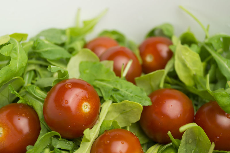 Close-up of tomatoes and spinach in container