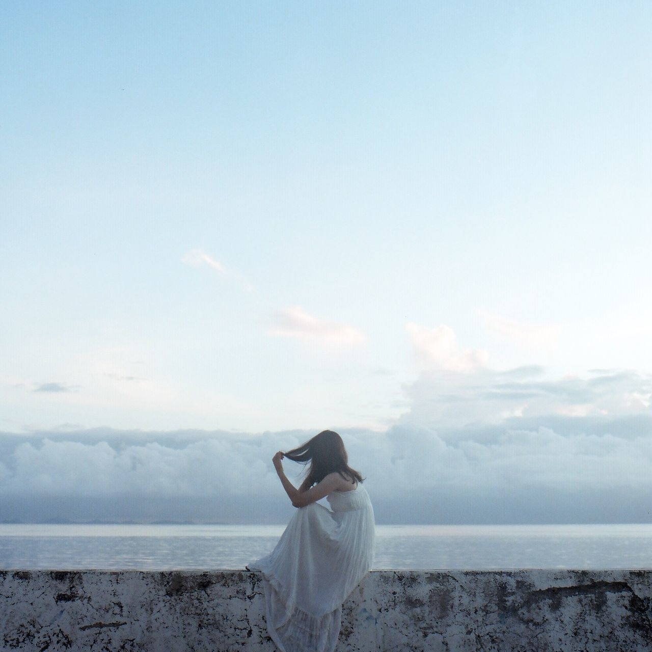 sky, standing, sea, one person, real people, cloud - sky, horizon over water, nature, water, rear view, day, outdoors, women, beauty in nature, tranquil scene, young adult, scenics, beach, leisure activity, tranquility, young women, wedding dress, bride, adult, people