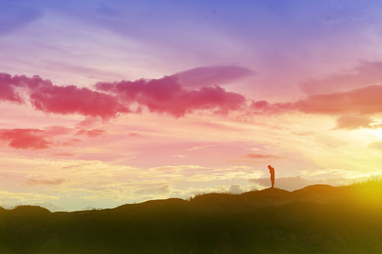 Arms Raised Beauty In Nature Cloud - Sky Environment Human Arm Idyllic Landscape Lifestyles Mountain Nature Non-urban Scene One Person Orange Color Outdoors Real People Scenics - Nature Silhouette Sky Standing Sunset Tranquil Scene Tranquility