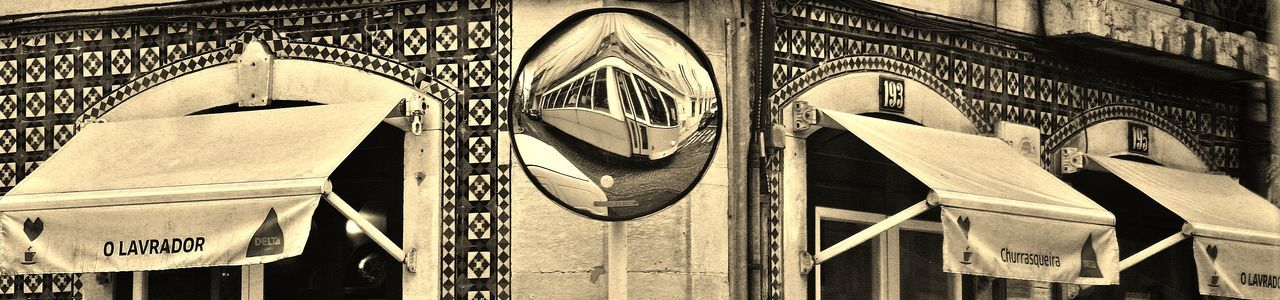 Lisbon Lisboa Portugal Streetphotography Mirror Reflection Black And White Distorted Reflection Tiled Wall Tiles Canopes Postbox Shape Tram Tram Reflection Mobility In Mega Cities