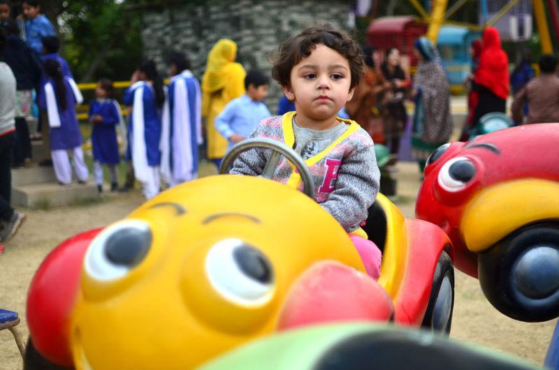 Happy girl playing at playground