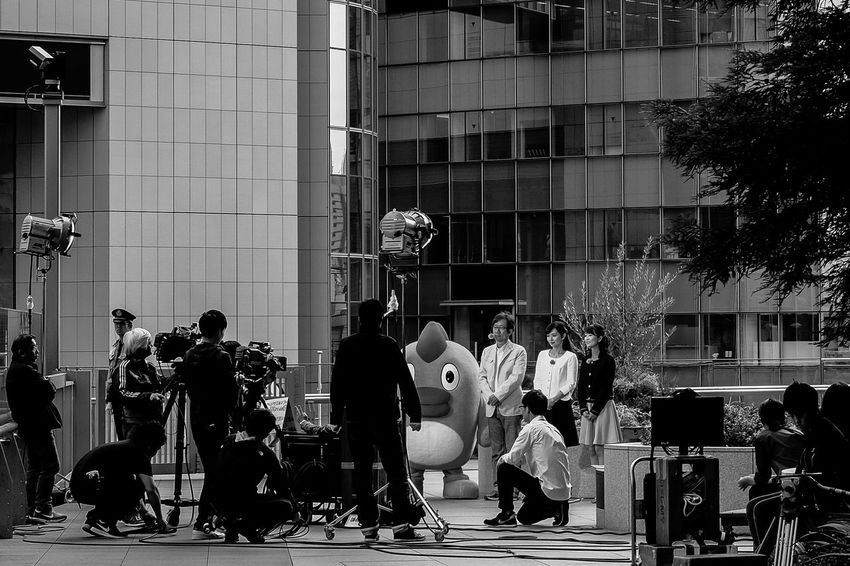 This is the landscape of broadcasting of whether forecast TV show. They are Japanese famous whether forecasting casters. Architecture Building Building Exterior Built Structure Casual Clothing City City Life City Street Fujifilm X-pro2 Fujifilm_xseries Group Of People Large Group Of People Lifestyles Mascot Characters Of JAPAN Medium Group Of People Men Mixed Age Range Modern Nippon Television Outdoors Person The Photojournalist - 2016 EyeEm Awards The Street Photographer - 2016 EyeEm Awards Tv Show Xf35mmf2
