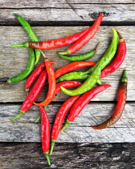 Fresh & spicy Crafted Beauty Day Close-up Ingredient Healthy Eating High Angle View Raw Food Food No People Wood - Material Freshness Green Color Food And Drink Spice Red Vegetable Chili Pepper Green Chili Pepper Red Chili Pepper Fresh Outdoors EyeEmNewHere Food Stories