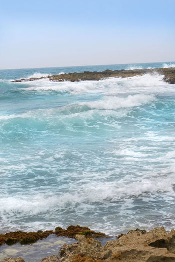 Coastal turquoise water with crashing waves Beach Beauty In Nature Day Horizon Over Water Land Outdoors Scenics - Nature Sea Sky Turquoise Turquoise Water Turquoise Water Color Water Wave