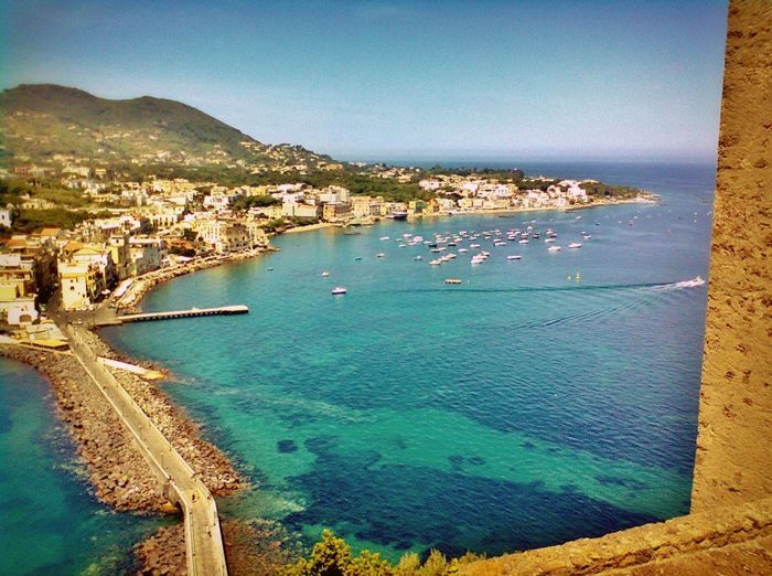 Water Sea Blue Travel Travel Destinations Architecture Sky Aerial View Tourism Coastline Nautical Vessel Outdoors City Built Structure Building Exterior No People Clear Sky Beach Scenics Vacations Ischia Aragon Castle Ischia