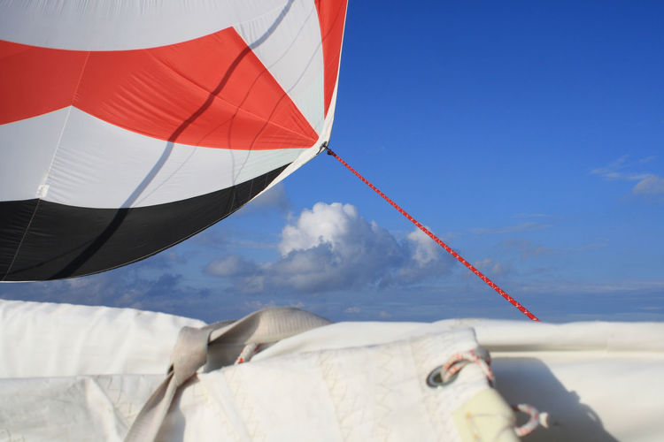 sailing yacht with black-white-red spinnacker, with mainsail down, with red spi-schot, in front of blue sky and white-grey clouds Copy Space Sail, Sail Away Spinnacker Adventure Blue Sky Cloud - Sky Day Extreme Sports Mainsail Nature No People Outdoors Rope Sky Sport Sunlight Wind Yacht EyeEmNewHere
