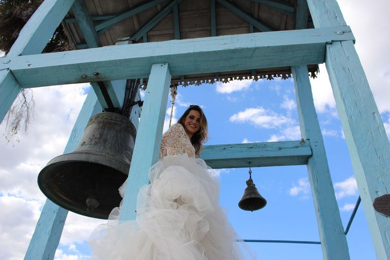 Low angle view of bride in bell tower