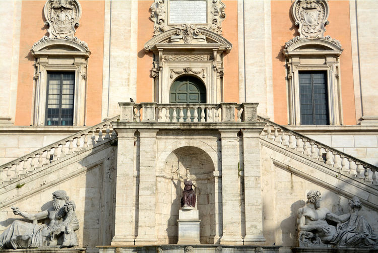 Statues outside historic building