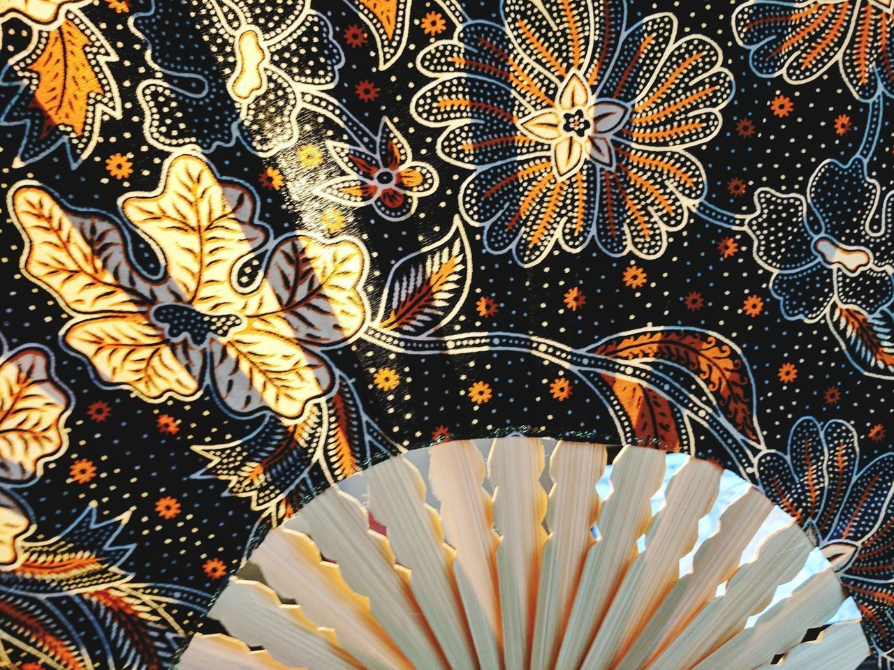 pattern, indoors, design, no people, close-up, floral pattern, backgrounds, art and craft, creativity, textile, decoration, hand fan, full frame, still life, craft, multi colored, yellow, white color, high angle view, clothing, embroidery, luxury