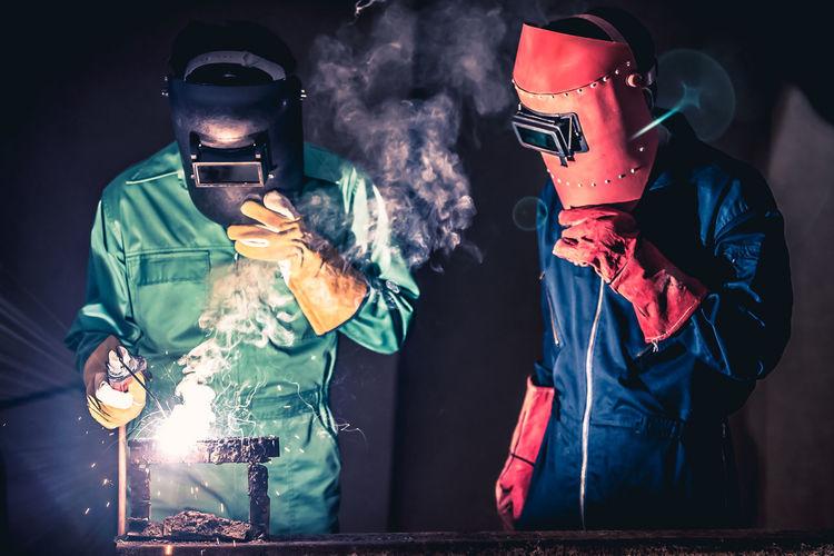 Mechanics welding in workshop