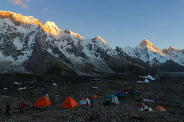 camping tents on the way to K2 base camp with karakorum range in background in the evening time Camping Hiking Sunlight Adventure Beauty In Nature Camping Cold Temperature Environment Glacier Group Of People Hiking Landscape Leisure Activity Light And Shadow Mountain Mountain Peak Mountain Range Nature Non-urban Scene Outdoors Peak Real People Scenics - Nature Shadow Sky Snow Snowcapped Mountain Sunrise Sunset Tent Tranquil Scene Travel Destinations Winter