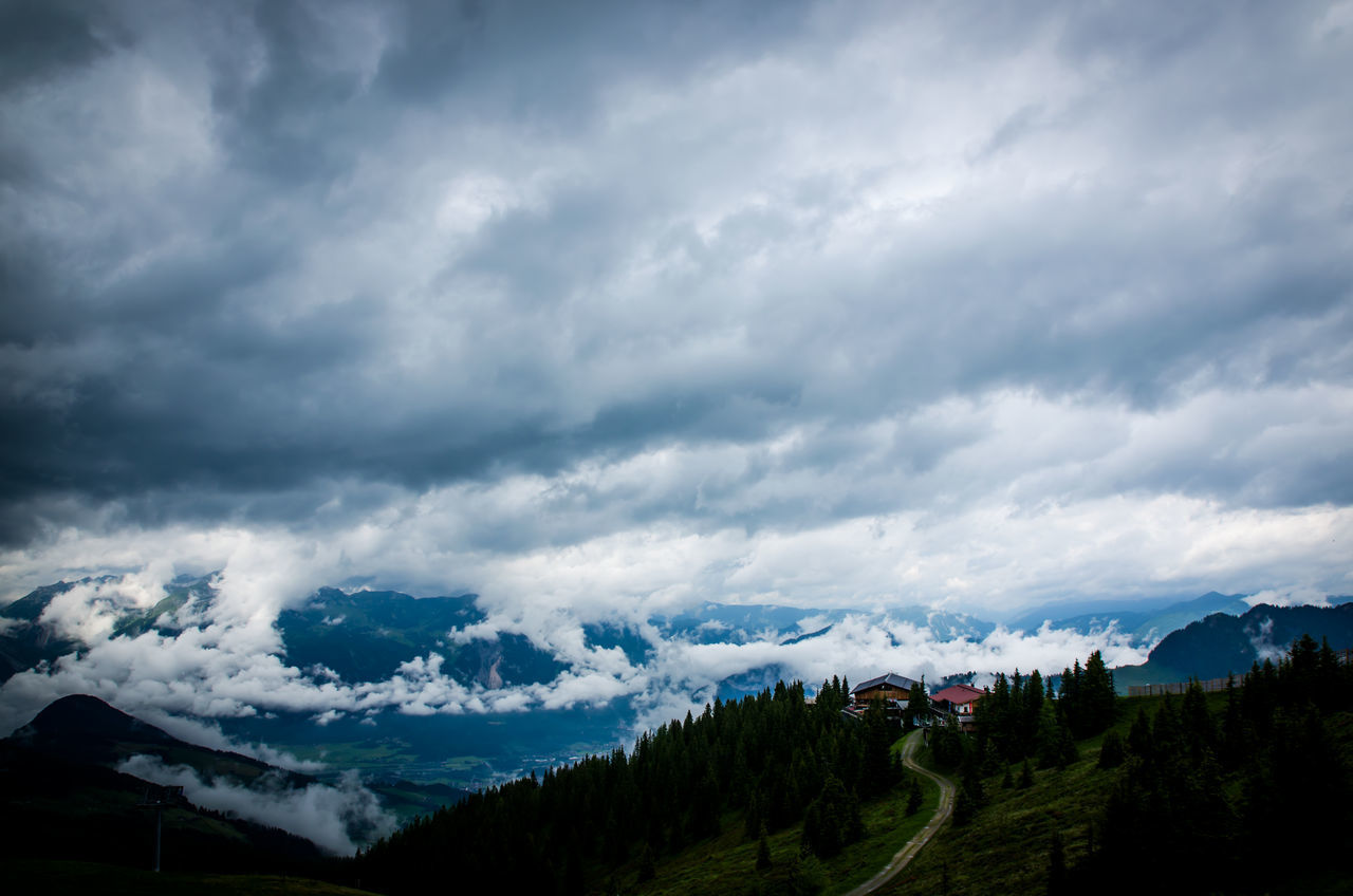 Dramatic sky over beautiful mountain range Mountain View Alps Architecture Beauty In Nature Building Exterior Cloud - Sky Cold Temperature Day Dramatic Sky Landscape Mountain Mountain Range Nature No People Outdoors Range Scenics Sky Snow Storm Cloud Tranquil Scene Tranquility Travel Destinations Tree Weather