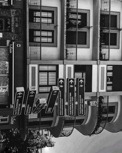 Buildings seen through window in city