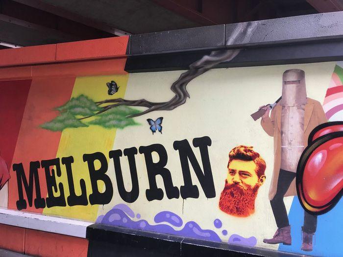 Wall art in Southbank Australia Australia Southbank Melbourne Ned Kelly Text Communication Human Representation Western Script Art And Craft Representation Creativity Multi Colored Male Likeness Graffiti Day Street Art Outdoors Wall - Building Feature Mural Sign