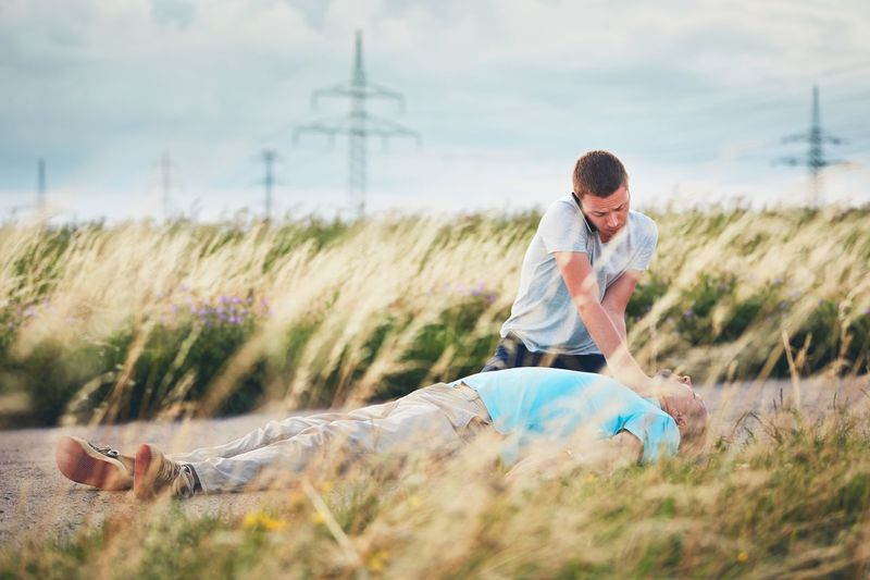Full length of man lying on grass against sky