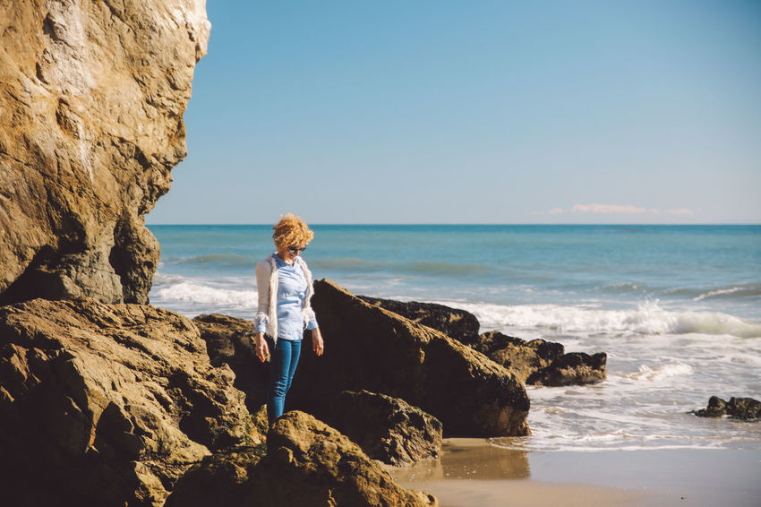 California El Matador Beach Pacific Beach Beauty In Nature Clear Sky Curly Hair Day Full Length Girl Horizon Over Water Leisure Activity Lifestyles Looking At Camera Nature Ocean One Person Outdoors People Portrait Real People Rock - Object Rock Formation Scenics Sea Sky Standing Water Wave Young Adult Young Women California Dreamin