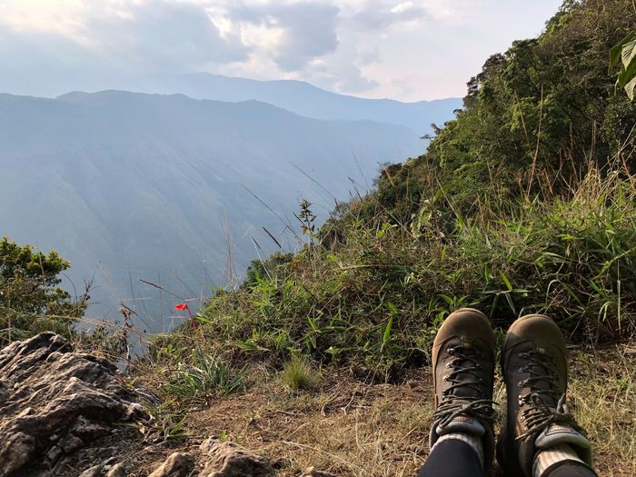 These boots were made for trekking and that's just what they'll do EyeEmNewHere Trekking Walking Boots Boots Boot Mountain Human Leg Low Section Real People One Person Beauty In Nature Personal Perspective Mountain Range Nature Sky Day Shoe Scenics - Nature Cloud - Sky EyeEmNewHere