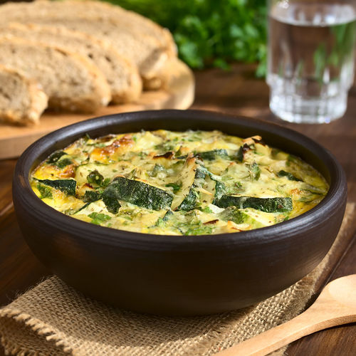 Frittata with zucchini and parsley in rustic bowl, photographed with natural light (Selective Focus, Focus one third into the first frittata) Breakfast Dish Frittata Herb Meal Snack Vegetarian Vegetarian Food Zucchini Baked Bowl Brunch Courgette Egg Food Food And Drink Freshness Healthy Eating Italian Italian Food Omelett Omelette Parsley Ready-to-eat Vegetable