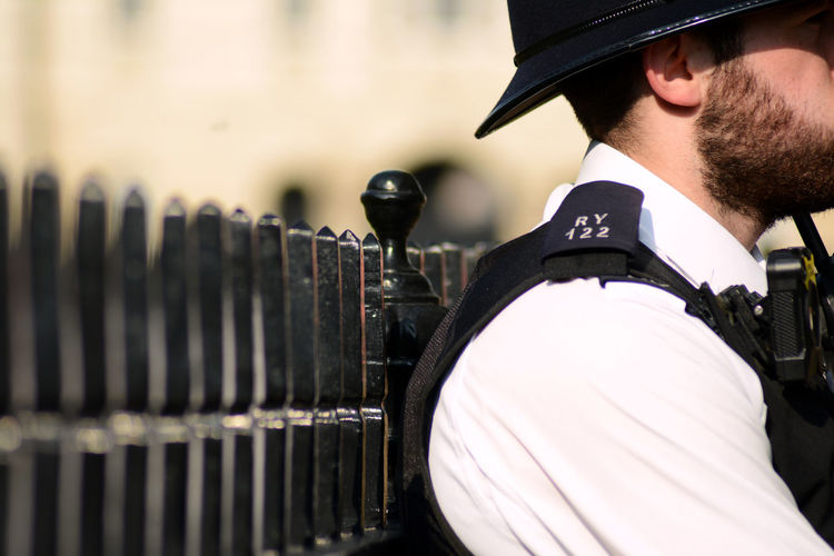 London Black Color Clothing Day Daylight Daytrip Fence Fencepost Focus On Foreground Government Hat Helmet Men Occupation Outdoors Police Police Force Protection Real People Responsibility Safety Security Uniform