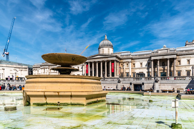 Brexit Britain London National Gallery  Trafalgar Uk United Kingdom Architecture Art Attraction British Building Capital City Cityscape Classical Colonnade Culture Destination Dome England English Europe European  Exterior Façade Famous Fountain Historic Landmark Monument Museum Outdoor Place Reflection Road Scene Sightseeing Sky Square Sunny Tourism Touristic Transport Transportation Travel United Urban Weather Westminster