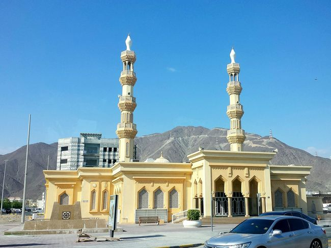 City Architecture Outdoors Sculpture Cityscape No People Day Fame Mosque Mosque Tower Mosques Arround The World Mosque Architecture Khor Fakkan Bergiges Hinterland Ladyphotographerofthemonth From A Moving Vehicle Through A Window Street Architecture Mosques Miles Away POV