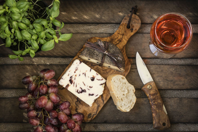 Alcohol Basil Bread Cheese Cheese! Cutting Board Day Directly Above Drink Food Food And Drink Freshness Glass Wine Grape Healthy Eating High Angle View Indoors  Leaf No People No People, Vine Wine Wine Moments Wood - Material