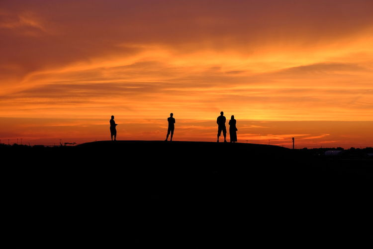 Looking Away Adult Cloud - Sky Clouds And Sky Group Of People Lifestyles Orange Color Real People Scenics - Nature Silhouette Sky Standing Sunset