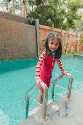 Portrait of girl in swimming pool