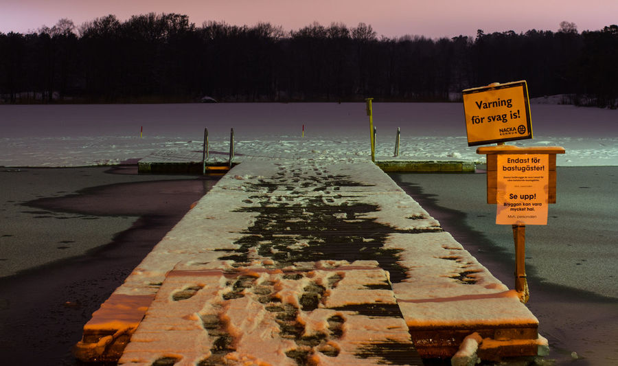 Cold Water Communication From Sauna To Water Guidance Ice Water Nature Night No People Outdoors Road Construction Road Sign Sign Sky Sunset Sweden Nature Sweden Winter Swimming In The Lake Symbol Text Tree Very Cold Morning Water Wet Winter Bathi Winter Swimming
