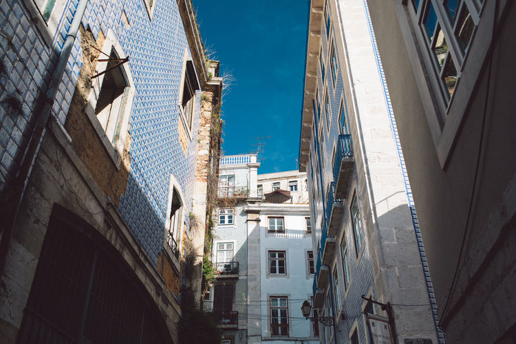 Lisbon Lisboa Lisboa Portugal Lisbon - Portugal Portugal Building Exterior Architecture Built Structure Building City Residential District Sky Day No People Nature Window Low Angle View Sunlight Outdoors Street Travel Destinations City Life Town Old Motor Vehicle Apartment Alley