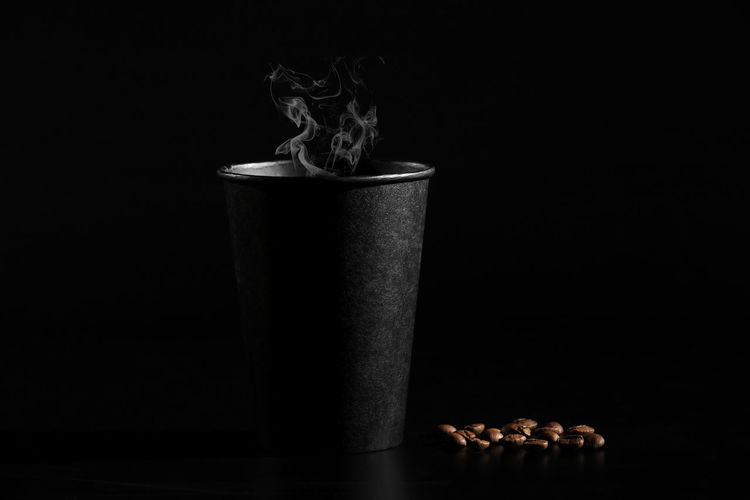 Close-up of coffee on table against black background
