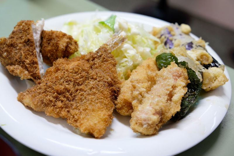 Close-Up Of Fried Meat And Salad In Plate