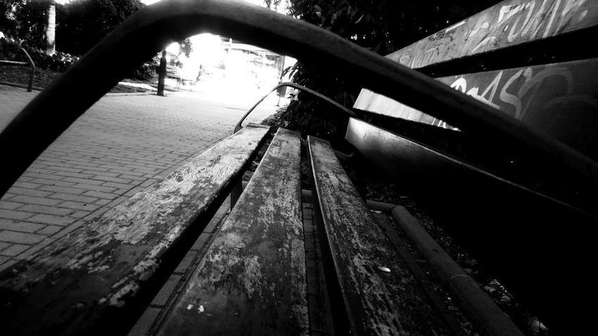Bench Benches Black And White Blackandwhite Close-up Day Focus On Foreground High Angle View Land Vehicle Metal Mode Of Transportation Monochrome Nature No People Outdoors Park Railing Reflection Tire Wood Wood - Material