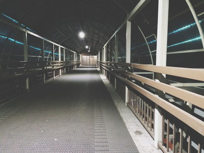 Empty illuminated skywalk
