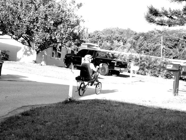 CyclingUnites Monochrome Photography Enjoying Life Fun Excercise Real People Snapshots Of Life Light And Shadow Blackandwhite Outdoors Nature On The Road Streetphotography Street Transportation Florida Life Cyclist Bicycle Florida Candid Sunny Day Suburban Exploration Individuality Uniqueness Adapted To The City