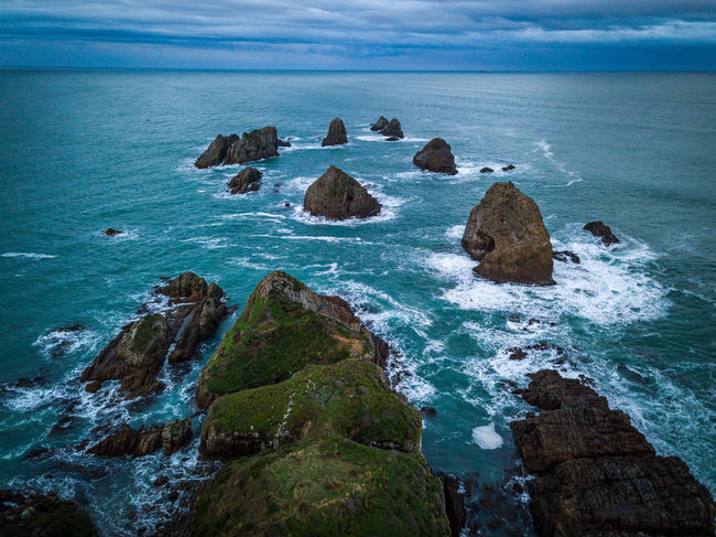 Nugget Point Lighthouse, Dunedin, Otago, New Zealand Nugget Point Lighthouse Otago Peninsula Beach Beauty In Nature Day Horizon Horizon Over Water Land Motion Nature New Zealand No People Outdoors Rock Rock - Object Rock Formation Rocky Coastline Scenics - Nature Sea Sky Solid Stack Rock Tranquil Scene Tranquility Water The Great Outdoors - 2018 EyeEm Awards