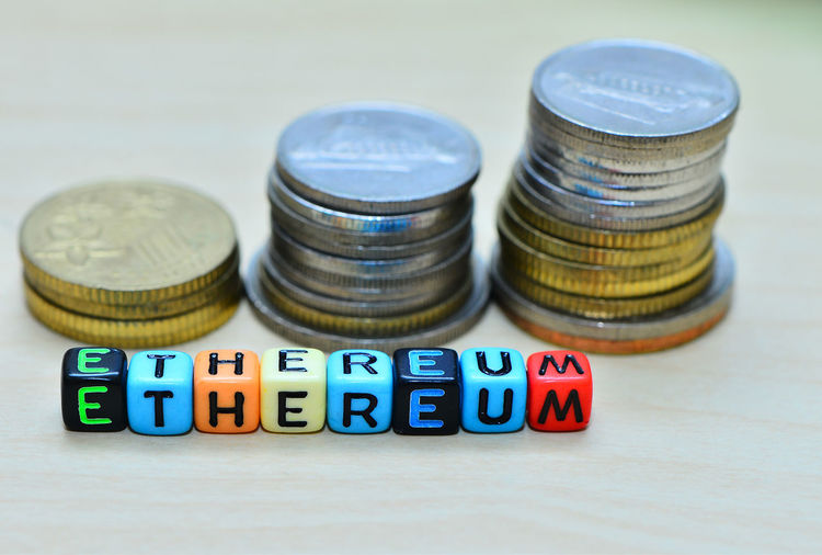 Ethereum text dice with stack of coins. wooden background. Digital Business Currency Money Gold Finance Financial Bitcoin Dice Gamble Electronic Banking Internet Market RISK Exchange Cash Golden Virtual Coin Bank Economy Pay Cryptography Payment Concept Win Gambling Gambling
