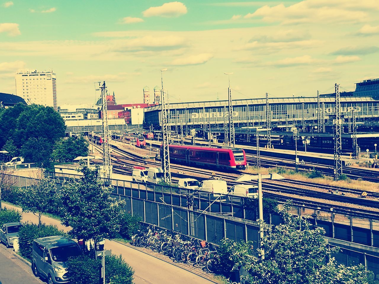 transportation, architecture, train - vehicle, built structure, mode of transport, rail transportation, public transportation, sky, connection, bridge - man made structure, high angle view, no people, tree, cloud - sky, city, day, outdoors, building exterior