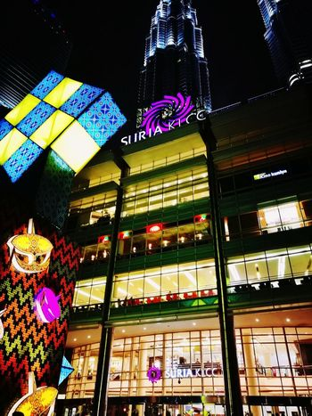 An iconic shopping mall in town. City Illuminated Multi Colored Celebration Store
