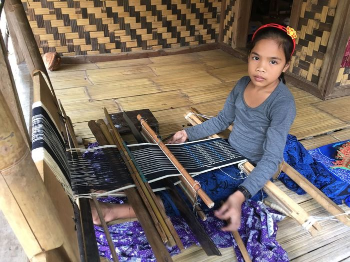 10 year old girl weaving in West Java Baduy West Java,Indonesia IPhoneography