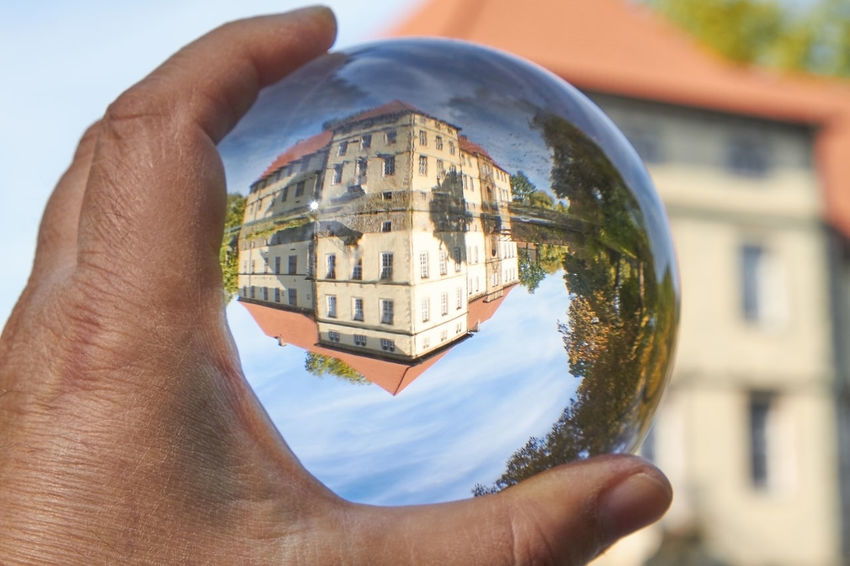 Water Castle Castle Architecture Ball Body Part Building Exterior Built Structure Close-up Day Finger Focus On Foreground Glass Hand Holding Human Body Part Human Finger Human Hand Lifestyles Magic Nature One Person Outdoors Personal Perspective Real People Sphere Unrecognizable Person Water Water Castle