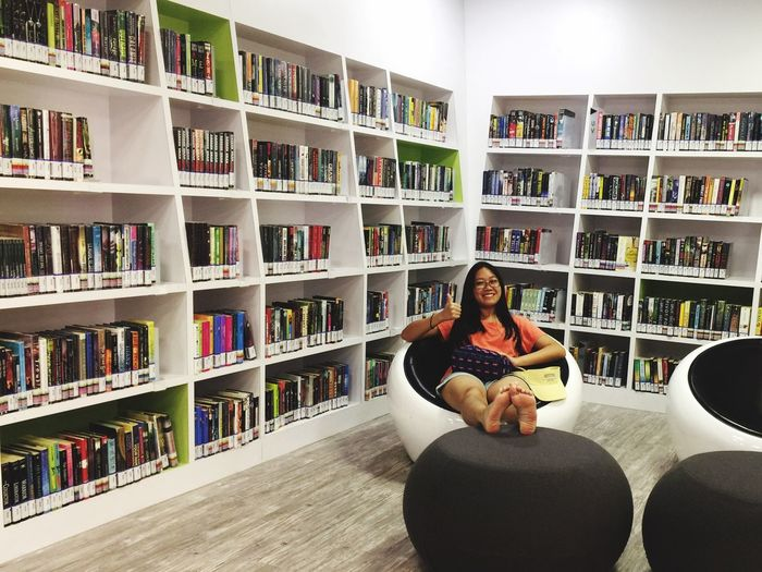 Always Be Cozy Sitting Bookshelf Full Length Book Cross-legged Indoors  Lifestyles One Person Learning Adults Only Domestic Life Only Women People Portrait Living Room Real People Connection One Woman Only Leisure Activity Library Eyeem Singapore Eyem Gallery