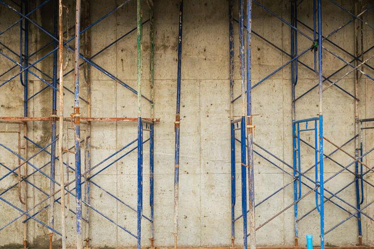 Full frame shot of ladder against wall