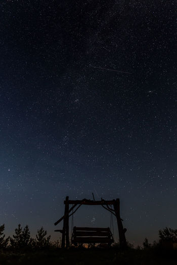 A swing under the stars Astronomy Astrophotography Beautiful Clear Sky Comets Cosmos Estonia Falling Stars Long Exposure Nature Night Night View Nightphotography No Clouds No People Outdoors Serene Sky Space Space And Astronomy Space Exploration Star - Space Star Field Stars Swing