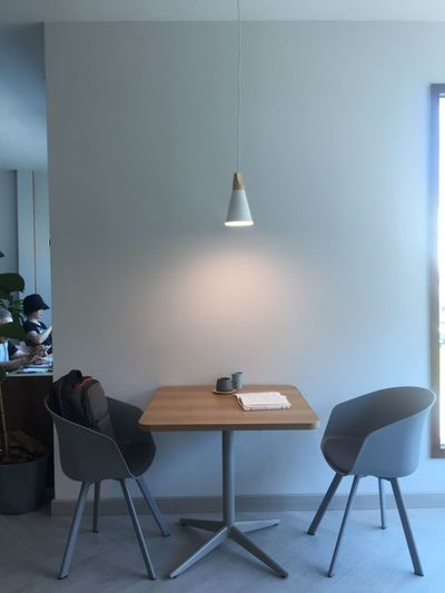 Table and chairs against wall at home